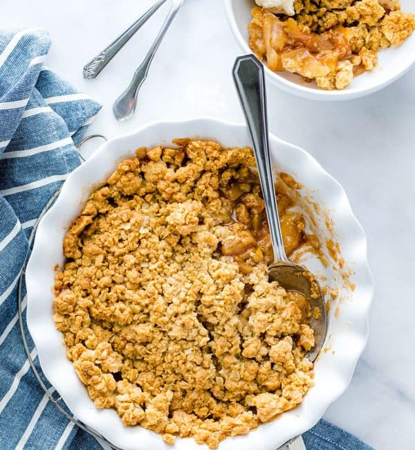 Gluten Free Apple Crisp in a round white baking dish