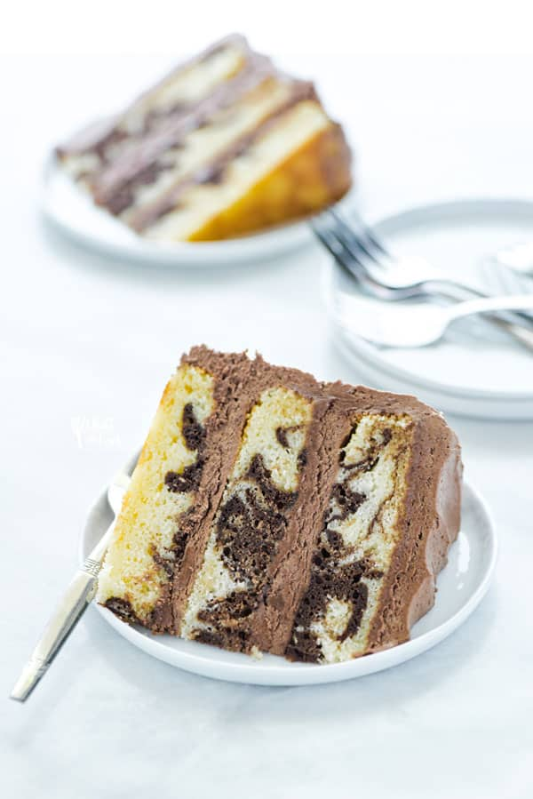 This is the best recipe for homemade gluten free marble cake! It's a moist, 3 layer vanilla cake swirled with chocolate cake batter. It's the perfect combination of chocolate and vanilla, perfect for indecisive dessert eaters! This is a stunning cake for any occasion - birthday cake, wedding cake, anniversary cake, baby shower, or bridal shower! Gluten Free Cake recipe from @whattheforkblog -visit whattheforkfoodblog.com for more gluten free desserts #glutenfree #cake #marblecake #glutenfreecake