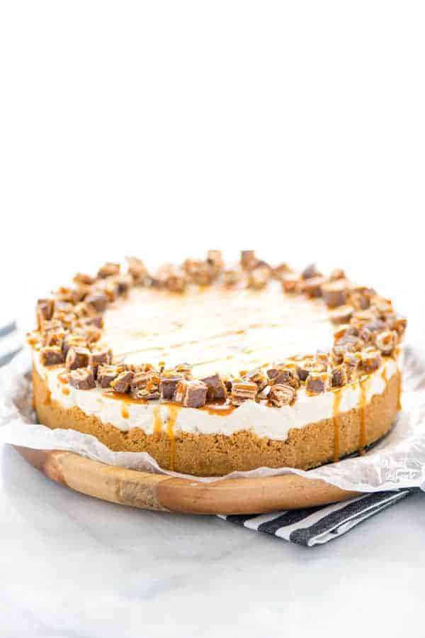 Gluten Free Chocolix No Bake Cheesecake recipe on a round wood board lined with wax paper