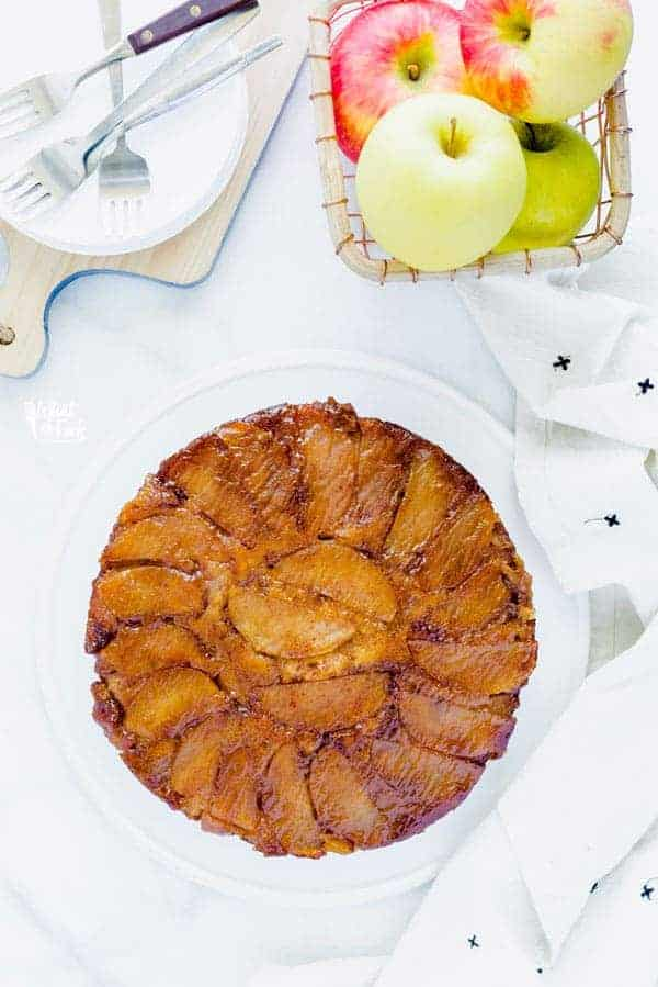 This Gluten Free Apple Upside Down Cake makes the most of fresh apples. It's definitely a Fall dessert you need to try this Thanksgiving. Moist and tender cake is covered with buttery caramelized apples. Top it with vanilla ice cream and a drizzle of caramel sauce. Easy gluten free dessert recipe from @whattheforkblog - visit whattheforkfoodblog.com for more gluten free desserts! #glutenfree #applerecipes #fallbaking #cake #upsidedowncake #Thanksgiving #caramelapple