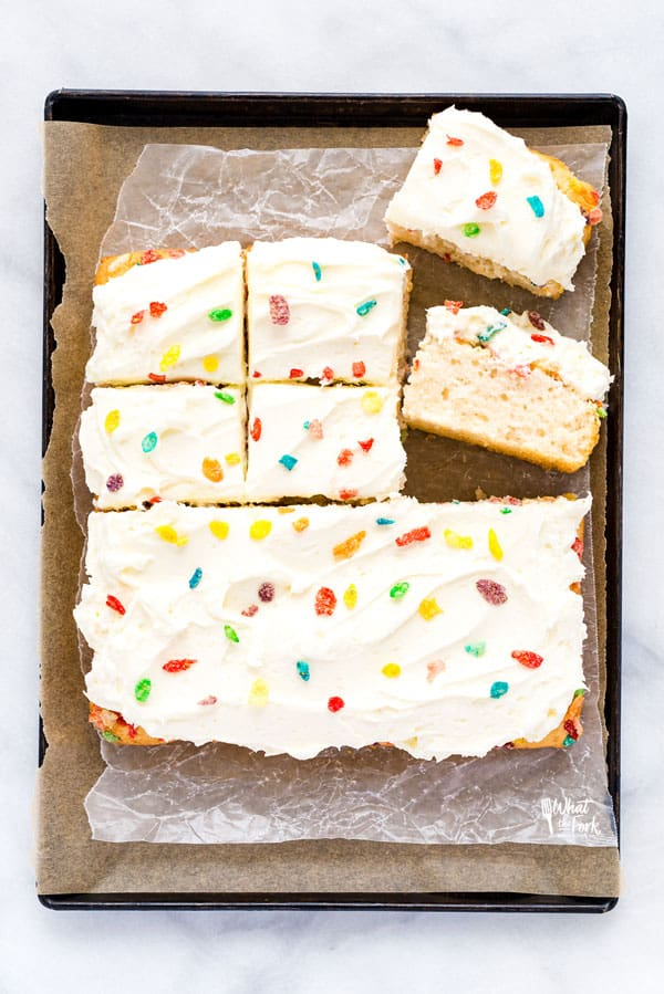 AD Finally, a gluten free cereal milk cake! This Gluten Free Fruity Pebbles Cake with Cereal Milk is a trendy cake that those on a gluten free diet can enjoy! It's a fluffy gluten free white cake made with Fruity Pebbles cereal milk and topped with even more Fruity Pebbles cereal. Finish it off with the best, creamy vanilla buttercream frosting and even more Fruity Pebbles. It's a gluten free dessert that anyone would enjoy, especially cereal lovers! #glutenfree #cerealmilk #cake #glutenfreecake