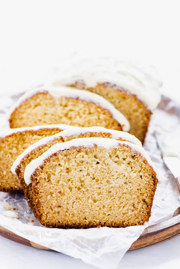 This simple and easy Gluten Free Eggnog Bread with Eggnog Icing is a wonderful holiday quick bread recipe. Baking with eggnog is one of the best ways to use leftover eggnog! The eggnog icing is spectacular but can be left off. This can also be baked as 4 mini loaves, the perfect size for gifting. Gluten Free Bread recipe from @whattheforkblog - visit whattheforkfoodblog.com for more! #glutenfree #glutenfreebread #eggnog #Christmas #holidaybaking #quickbread