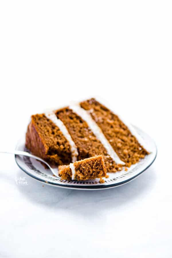 This show-stopping 3-layer gluten free gingerbread cake is the most amazing gluten free cake you'll ever have! It's moist with the perfect crumb and texture. It's perfectly spiced and pairs perfectly with cream cheese frosting. This cake is very simple to make and doesn't require a stand mixer or hand mixer, it can all be mixed by hand! If you don't want a 3 layer cake, it can also be baked as a 9x13 cake. It's the ultimate Christmas cake! #glutenfree #glutenfreecake #glutenfreedesserts #cake
