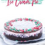This Peppermint Ice Cream Pie is a family Christmas tradition! It's our must-make Christmas dessert. This simple ice cream no-bake dessert recipe is so easy to make and it has to be made ahead of time so it's perfect for holiday parties. Make it gluten free with with a gluten free chocolate cookie crust or use regular Oreos if you don't need gluten free. Recipe from @whattheforkblog - visit whattheforkfoodblog.com for more! #Christmas #PeppermintStick #icecream #dessert #nobake #nobakerecipe