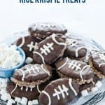 Chocolate Rice Krispies Treats are turned into Football Rice Krispie Treats for game day! They're a chocolate treat base cut into football shapes then dipped in chocolate with white laces piped onto resemble footballs. This easy, no-bake dessert is perfect for tailgating, football parties, playoff games, and Superbowl parties. Game day desserts are the best part about game day foods so these are a must make dessert recipe! #gamedayfood #footballfood #ricekrispietreats #glutenfree #nobakedessert