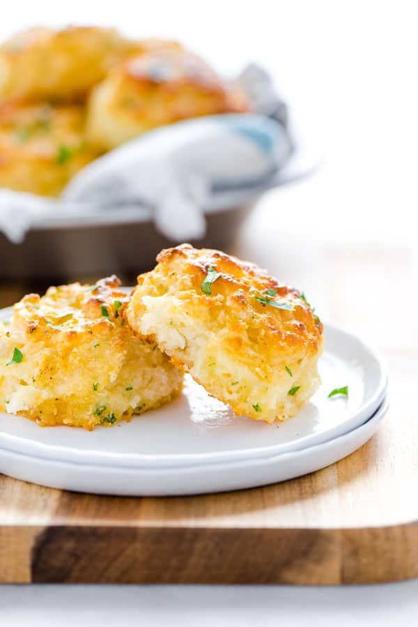 These Cheddar Bay Biscuits are the gluten free version of Red Lobster Biscuits. They're a basic gluten free drop biscuit flavored with spices, herbs, and cheese. Copycat Red Lobster cheddar biscuits are simple to make at home whenever the craving strikes. If you're tired of mediocre gluten free biscuit recipes, try this one and others from @whattheforkblog - you won't be disappointed with flavor and texture like regular biscuits. Visit whattheforkfoodblog.com for more #glutenfree #biscuits