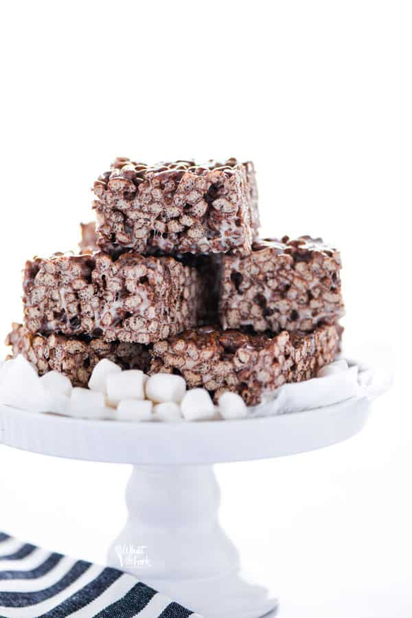Gluten Free Chocolate Rice Krispie Treats on a white cake stand