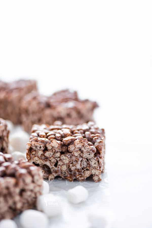 Gluten Free Chocolate Rice Krispie Treats on a marble surface