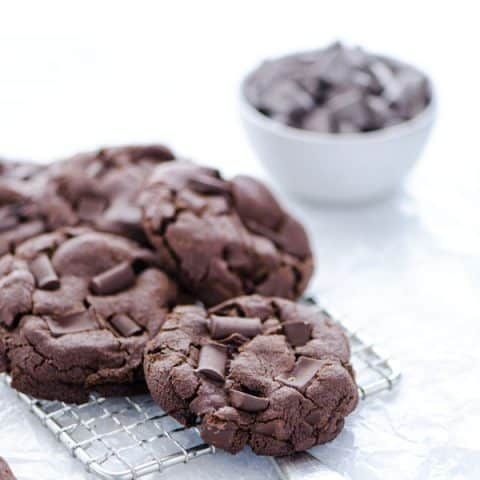 Gluten Free Double Chocolate Chip Cookies piled on a small wire metal rack