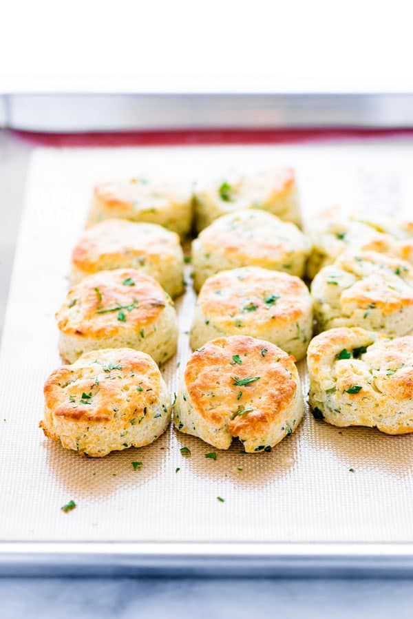 Finished gluten free biscuits recipe with garlic and herbs on a sheet pan