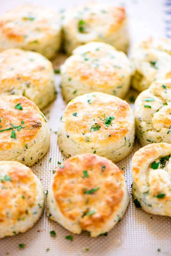 This is an easy Gluten Free Biscuits Recipe made with buttermilk and flavored with Garlic and Herbs. They're light and fluffy with amazing flavor and texture. They've got a nice crisp bottom and beautifully browned top. If you've been missing good biscuits since starting a gluten free diet, try this simple recipe! Lots of gluten free baking tips plus a recommendation for the best gluten free flour for these biscuits. #glutenfree #biscuits #glutenfreebiscuits #glutenfreebaking #glutenfreerecipes