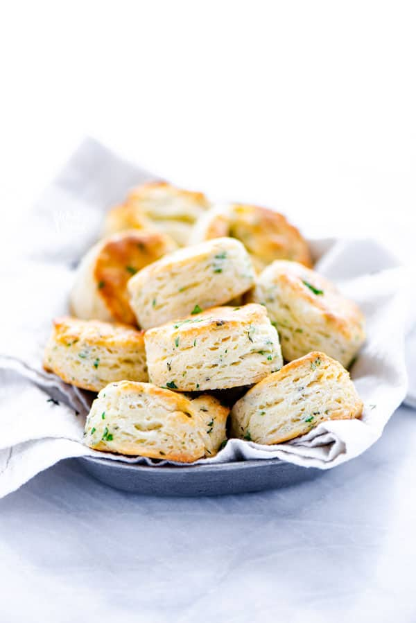 This is an easy Gluten Free Biscuits Recipe made with buttermilk and flavored with Garlic and Herbs. Theyre light and fluffy with amazing flavor and texture. They've got a nice crisp bottom and beautifully browned top. If you've been missing good biscuits since starting a gluten free diet, try this simple recipe! Lots of gluten free baking tips plus a recommendation for the best gluten free flour for these biscuits. #glutenfree #biscuits #glutenfreebiscuits #glutenfreebaking #glutenfreerecipes