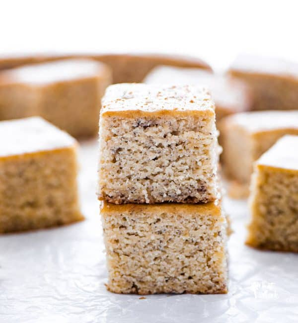 two slices of Gluten free banana bread bars stacked on wax paper