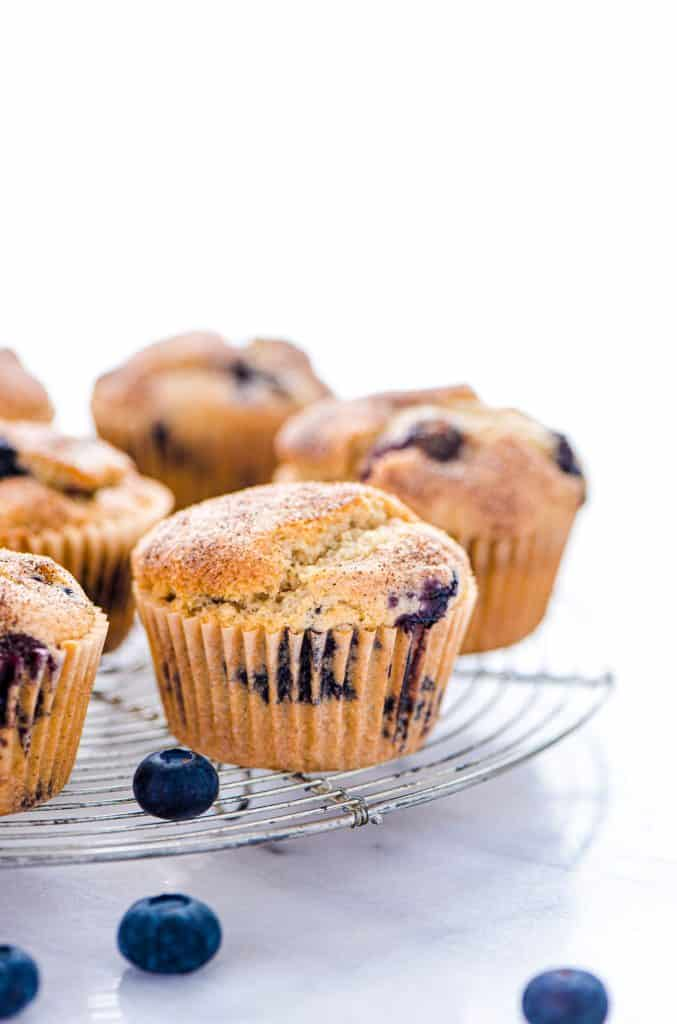 This is a really easy recipe for gluten free blueberry muffins. They're so tender and full of cinnamon flavor - they'll quickly become a go-to breakfast recipe! They freeze well too so go ahead and make a double batch! They're great for busy mornings. Gluten Free breakfast recipe from @whattheforkfblog | visit whattheforkfoodblog.com for more easy gluten free recipes and gluten free muffin recipes | homemade muffins | #glutenfree #dairyfree #muffins #breakfast #easyrecipes #blueberry