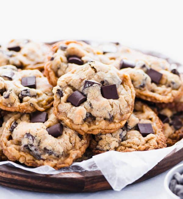 Gluten Free Oatmeal Chocolate Chip Cookies on a round wood platter lined with wax paper