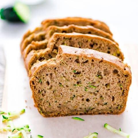 Gluten Free Zucchini Bread sliced on a small wood cutting board