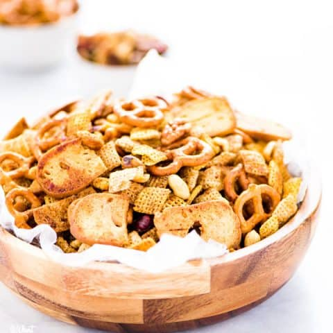 Sweet and Spicy Homemade Chex Mix in a wood bowl lined with wax paper