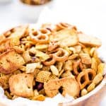 Your favorite Chex Mix recipe gets a sweet and spicy update that's crazy addicting! It's the perfect party snack and super easy to make. If you love classic Chex Snack Mix, you'll love this version. It's slightly sweet, slightly savory, and you can control how spicy you want it by increasing or decreasing the amount of cayenne pepper to your liking. This is a staple snack for holiday parties, bbq's, and game day. Recipe is made gluten free but can be made with regular pretzels and bagel chips.