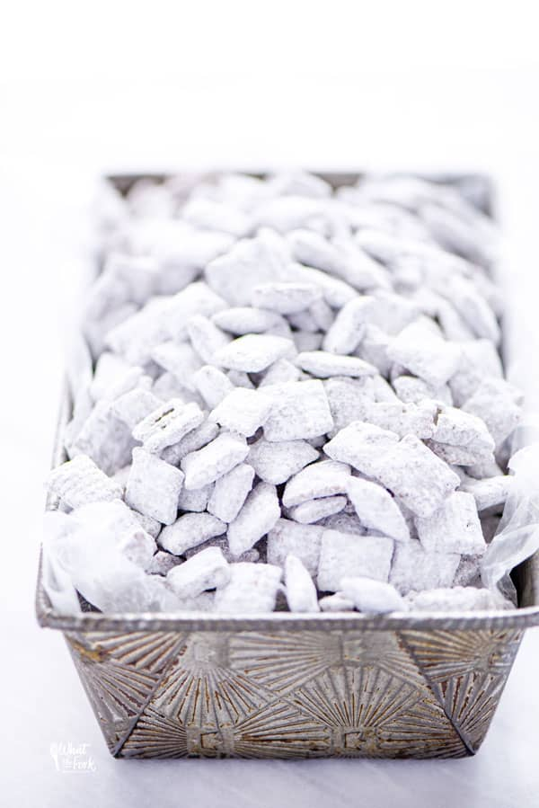 Gluten Free Puppy Chow in a silver vintage loaf pan
