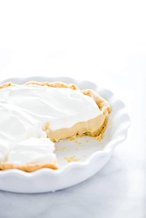 Maple Cream Pie in a white pie dish that's been cut into
