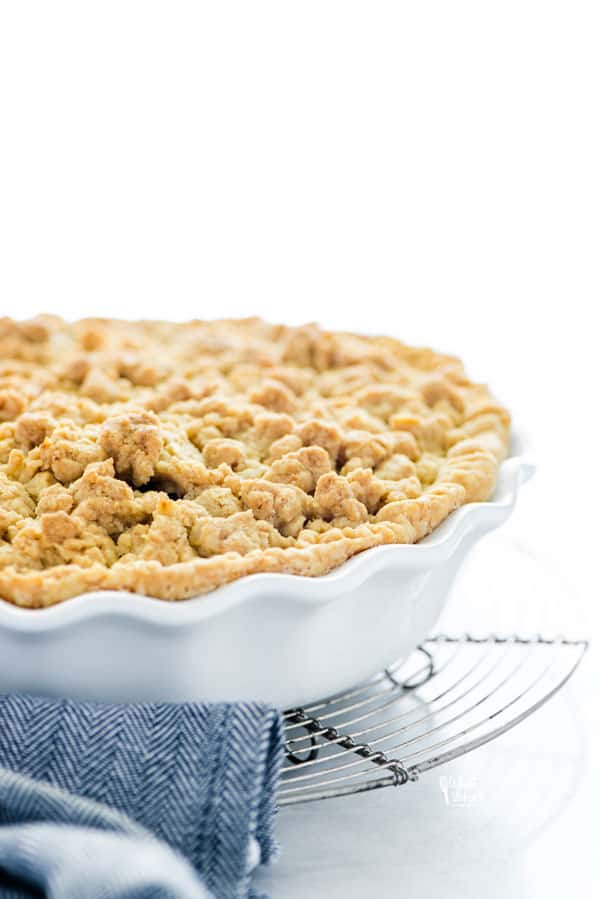 gluten free apple crisp pie in a white pie dish ready to be served