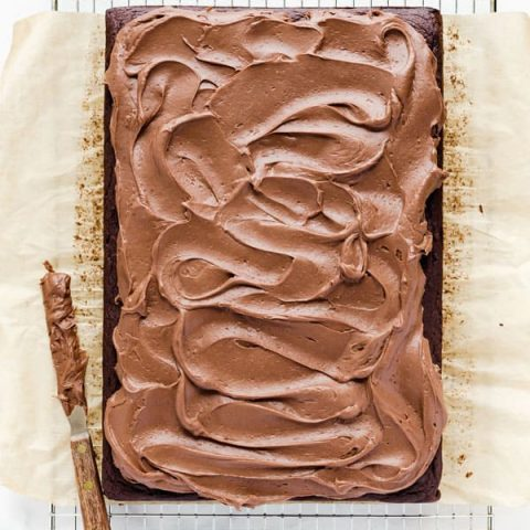 Chocolate Cream Cheese Frosting spread on a chocolate sheet cake