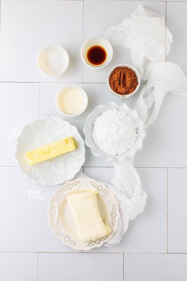 ingredients for chocolate cream cheese frosting in individual bowls and plates