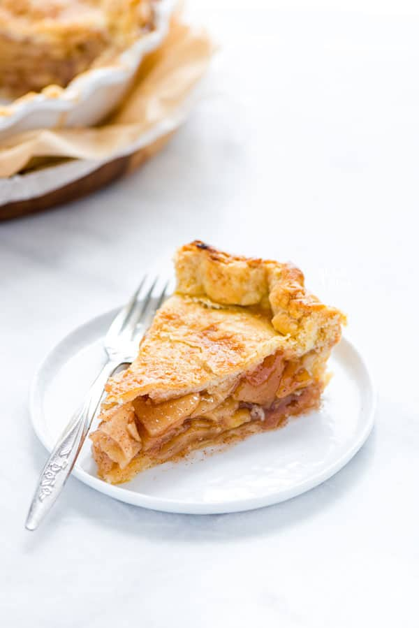 a slice of gluten free apple pie on a small white plate