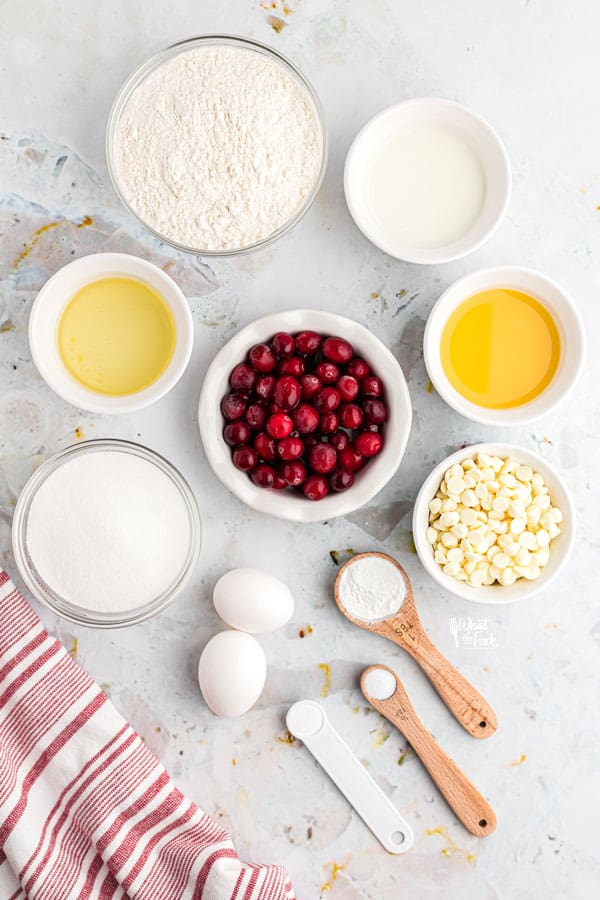 ingredients in individual bowls for white chocolate cranberry muffins