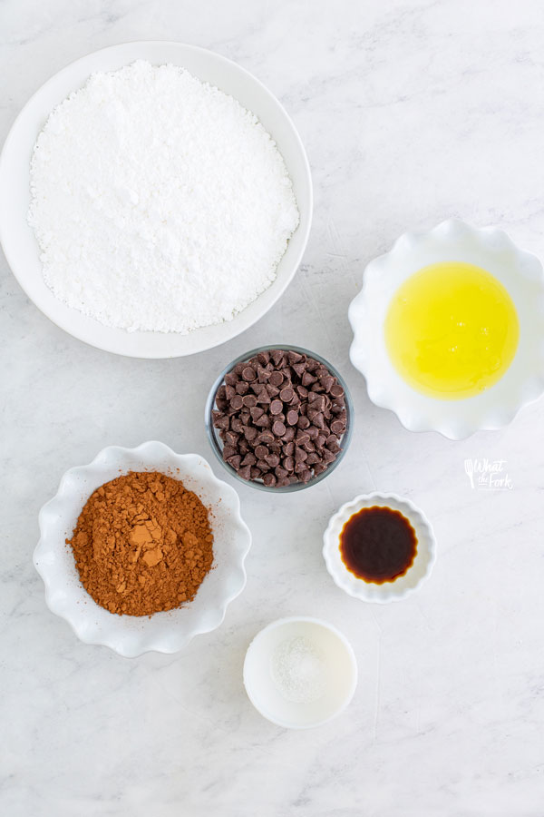 ingredients for flourless chocolate cookies in individual bowls