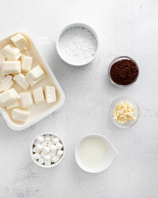 ingredients for white hot chocolate bombs in individual bowls