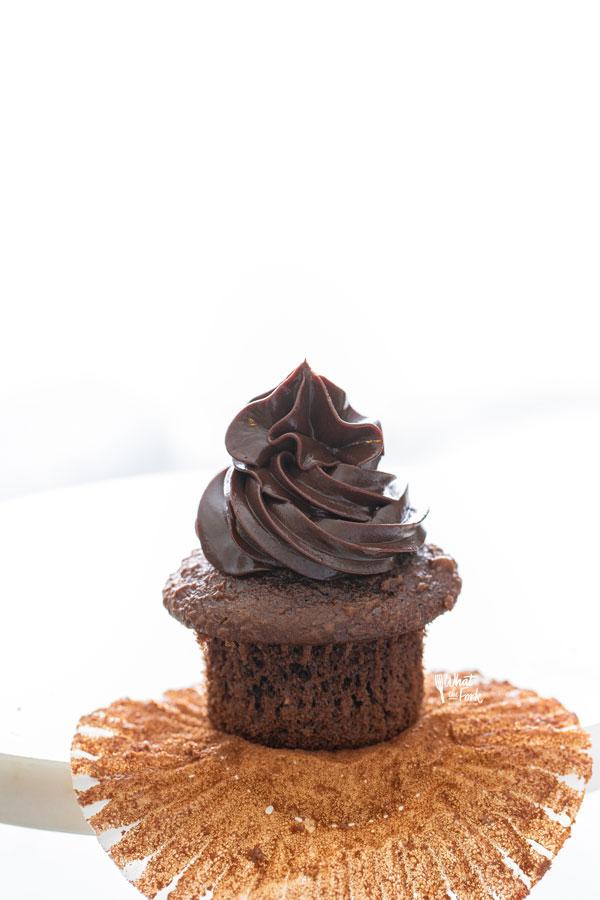 chocolate ganache pipped onto a chocolate cupcake