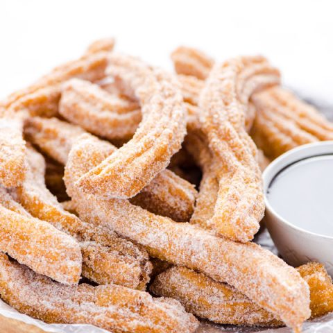 gluten free churros recipe on a wood platter ready to be served