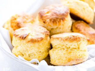 gluten free scones in a white bowl lined with a white napkin