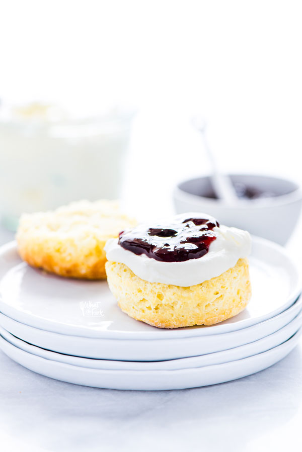 a gluten free scone split in half and topped with clotted cream and jam