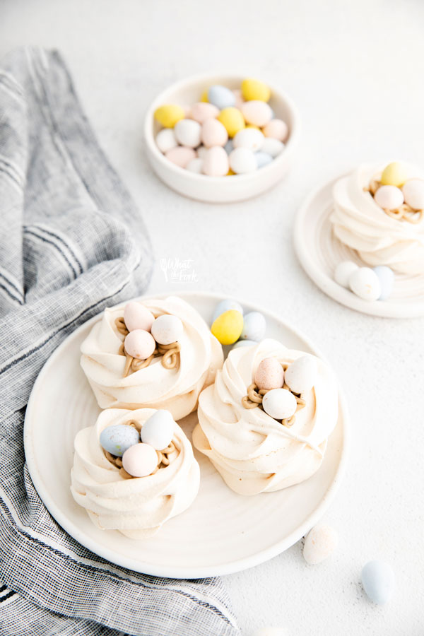 Easter Meringue Nests on a white plate with Mini Cadbury Eggs