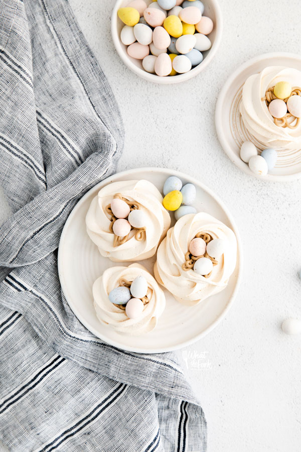 overhead shot of Easter Meringue Nests on a white plate