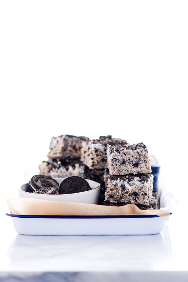 Gluten Free Cookies and Cream Rice Krispie Treats on an enamel tray lined with unbleached parchment paper