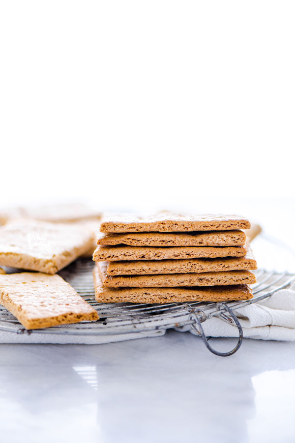 a stack of gluten free graham crackers on a round wire metal cooling rack