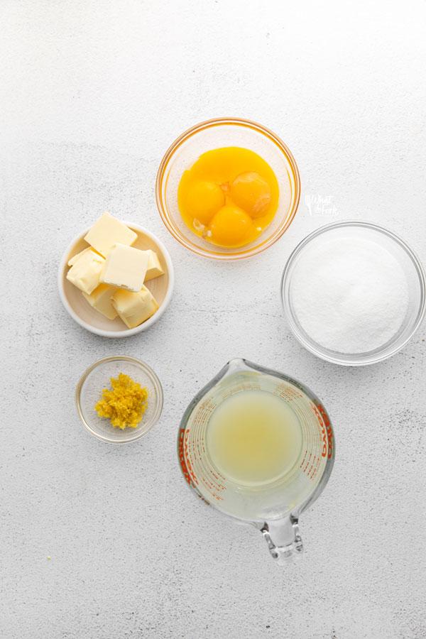 overhead shot of lemon curd ingredients in individual bowls