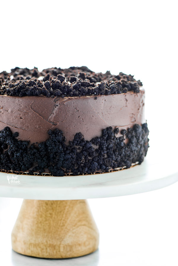 straight on shot of a Gluten Free Brooklyn Blackout Cake on a white marble cake stand with a wood base
