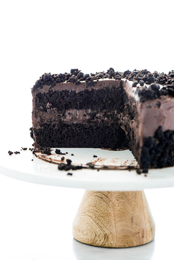 straight on shot of a Gluten Free Brooklyn Blackout Cake that has been sliced showing the layers of the cake