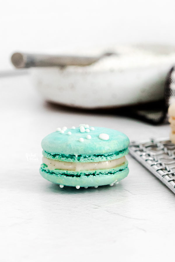 a blue French Macaron on a white surface