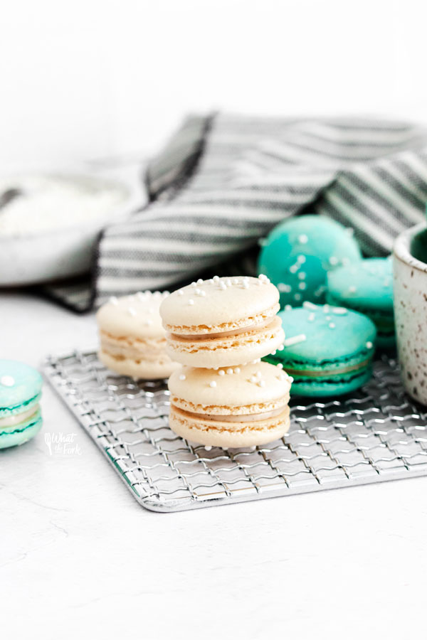 How to Make Macarons (French Macarons) stacked on a small wire rack