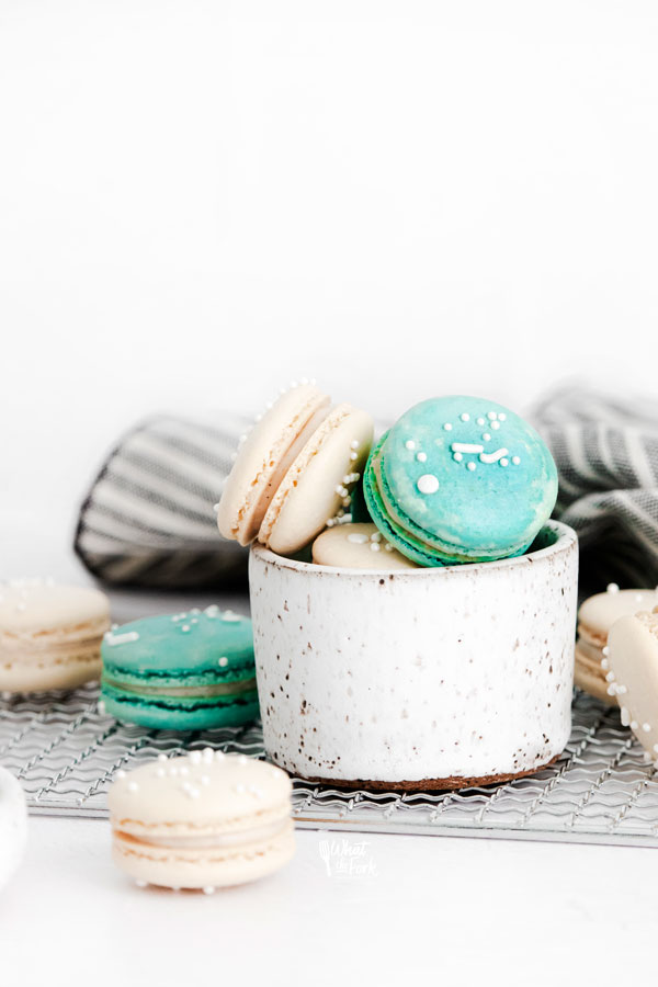 white and blue French Macarons in a small pottery bowl