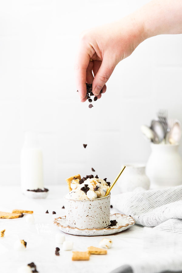 mini chocolate chips being sprinkled on top of No Churn S'mores Ice Cream