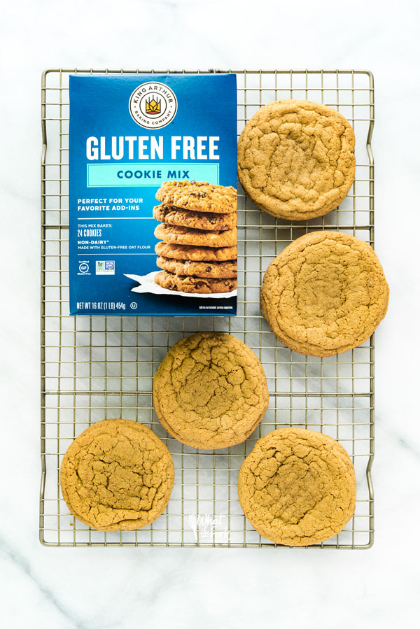 overhead shot of Gluten Free Brown Sugar Cookies on a wire rack with a box of King Arthur Gluten Free Cookie Mix