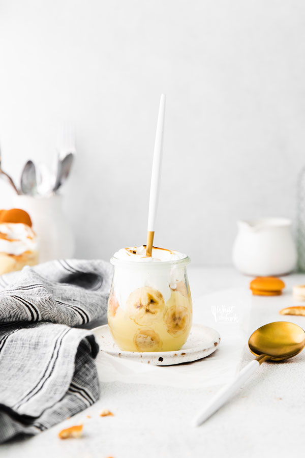Banana Pudding Recipe in a small glass jar with a white handled spoon sticking out
