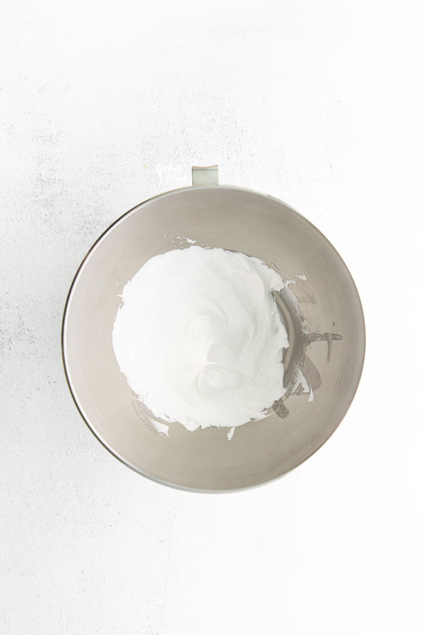 overhead shot of meringue in a large silver bowl