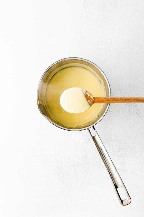 homemade vanilla pudding in a pot for a Banana Pudding Recipe